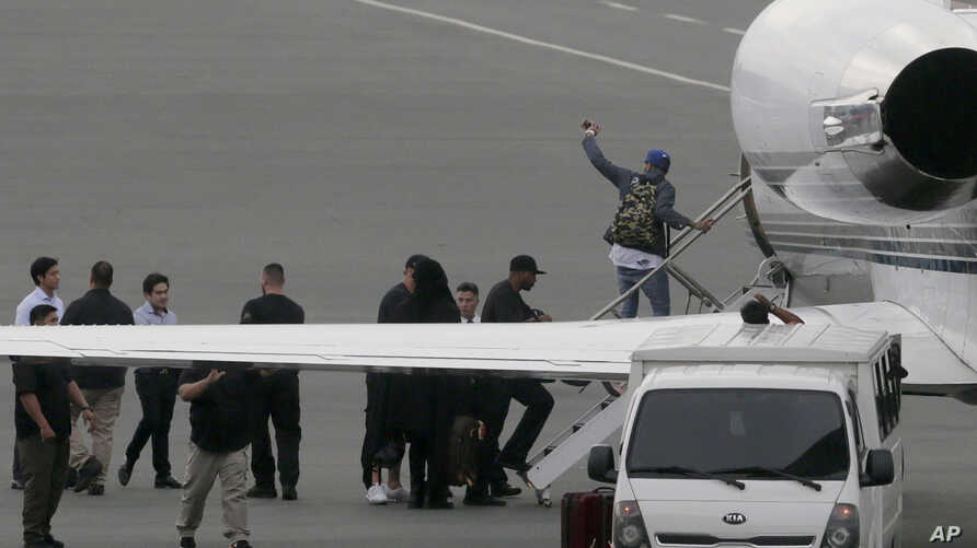 Grammy award-winning singer Chris Brown boards a chartered jet at the old Manila Domestic Airport in suburban Pasay city, south of Manila, Philippines, July 24, 2015.