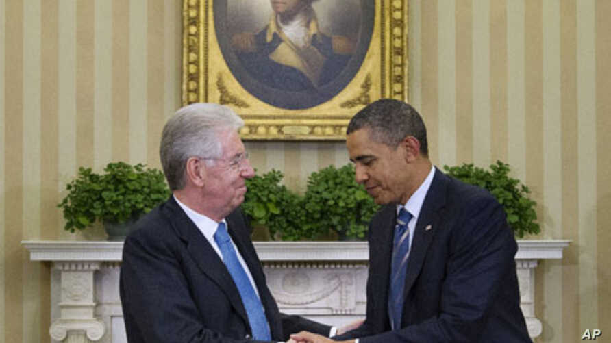 President Barack Obama meets with Italian Prime Minister Mario Monti in the Oval Office of the White House in Washington, February 9, 2012.
