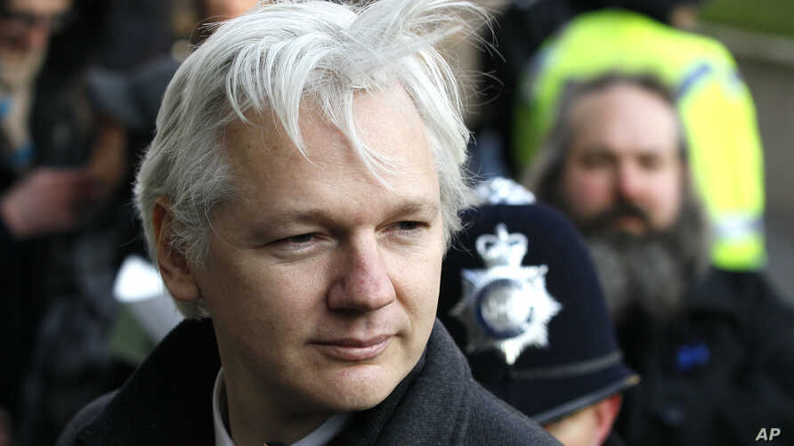 In this Feb. 1, 2012 file photo, Julian Assange, the 40-year-old WikiLeaks founder, arrives at the Supreme Court in London.