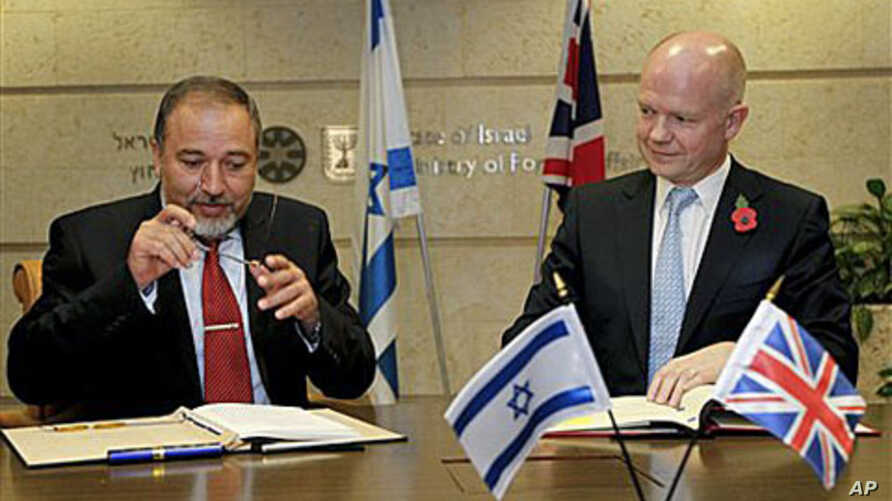 British Foreign Secretary William Hague, right, meets with his Israeli counterpart Avigdor Lieberman as they prepare to sign an agreement which will increase cooperation between the two countries' film industries, in Jerusalem, 3 Nov 2010