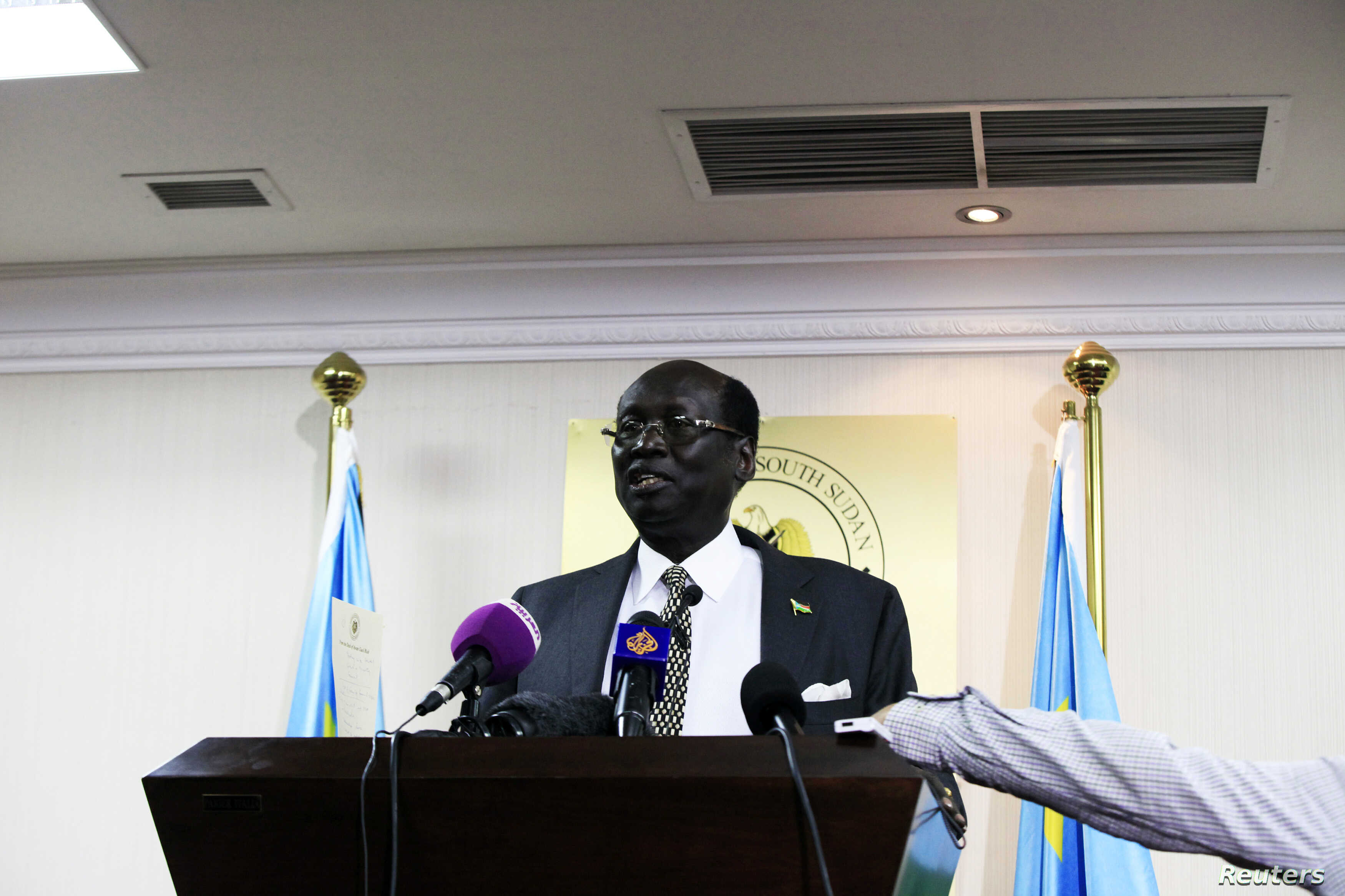 South Sudan Foreign Minister Barnaba Marial Benjamin, seen here on Aug. 12, 2014, in Juba, says the status of foreign workers will be discussed further at a later date.