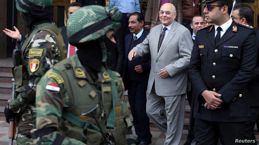 Ghad party chairperson Mousa Mostafa Mousa leaves the National Election Authority, which is in charge of supervising the 2018 presidential election, in Cairo, Egypt, Jan. 29, 2018.