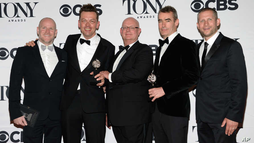"Simon Stephens, second right, Michael Morris, second left, and the crew accept the award for best play for ""The Curious Incident of the Dog in the Night-Time"" at the 69th annual Tony Awards at Radio City Music Hall on Sunday, June 7, 2015, in New Yor"