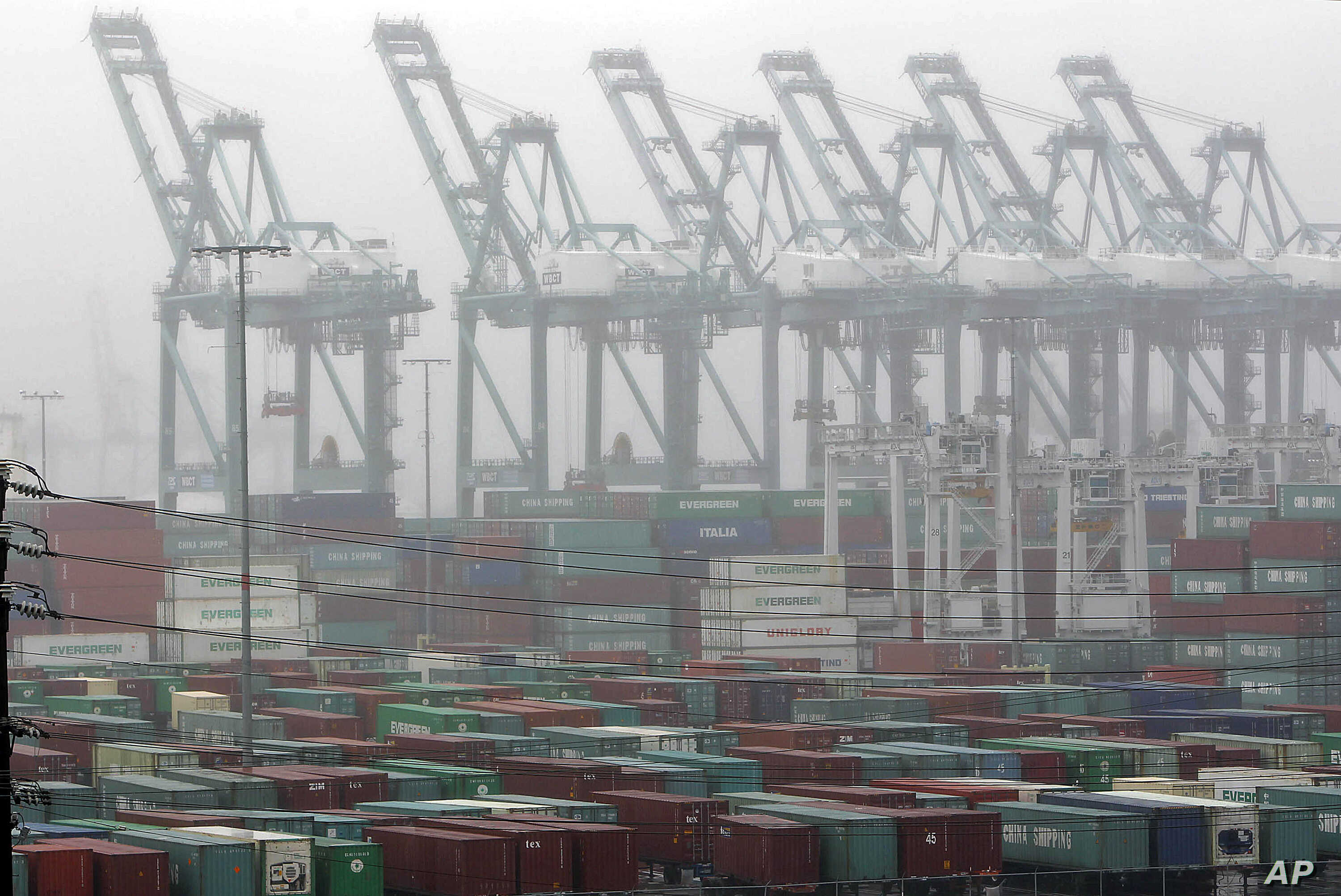 The Maersk cargo terminal, where container-handling cranes are in the up and idle position, is seen at the Port of Los Angeles Thursday, Nov. 29, 2012. Cargo ships were stacking up at the ports of Los Angeles and Long Beach as a strike by about about