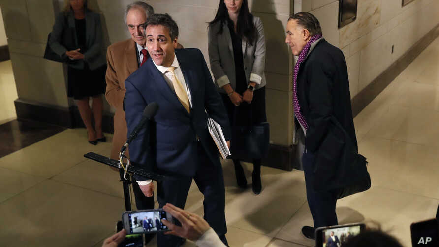 Michael Cohen, President Donald Trump's former lawyer, speaks briefly to the media as he leaves a closed-door hearing of the House Intelligence Committee accompanied by his lawyer, Michael Monico, Feb. 28, 2019, on Capitol Hill in Washington.