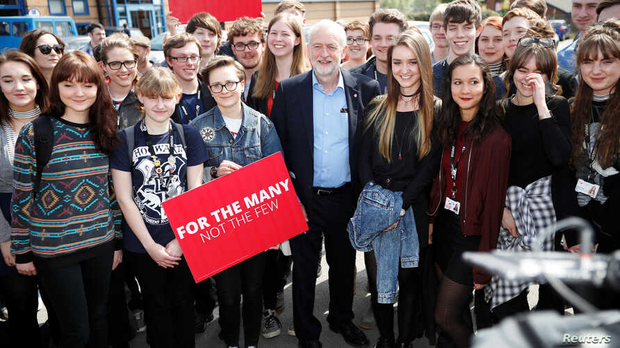Jeremy Corbyn, the leader of Britain's opposition Labour Party, poses for a picture with first time voters at a campaign event in Garfoth, Leeds, May 10, 2017.