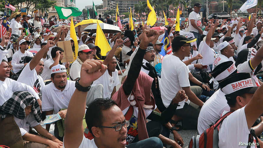 People take part in an Anti-ICERD (International Convention on the Elimination of All Forms of Racial Discrimination) mass rally in Kuala Lumpur, Malaysia, Dec. 8, 2018.