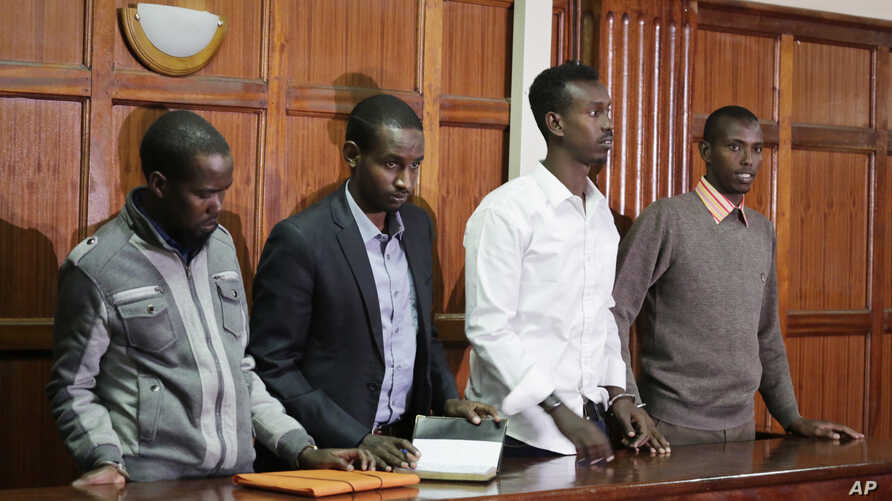 Left to right, Hussein Hassan Mustafah, Adan Dheq, Liban Abdullah Omar, and Mohamed Ahmed Abdi, who are charged with aiding the gunmen involved in the Westgate Mall attack in Sept. 2013, appear during their ongoing trial at Milimani court in Nairobi,