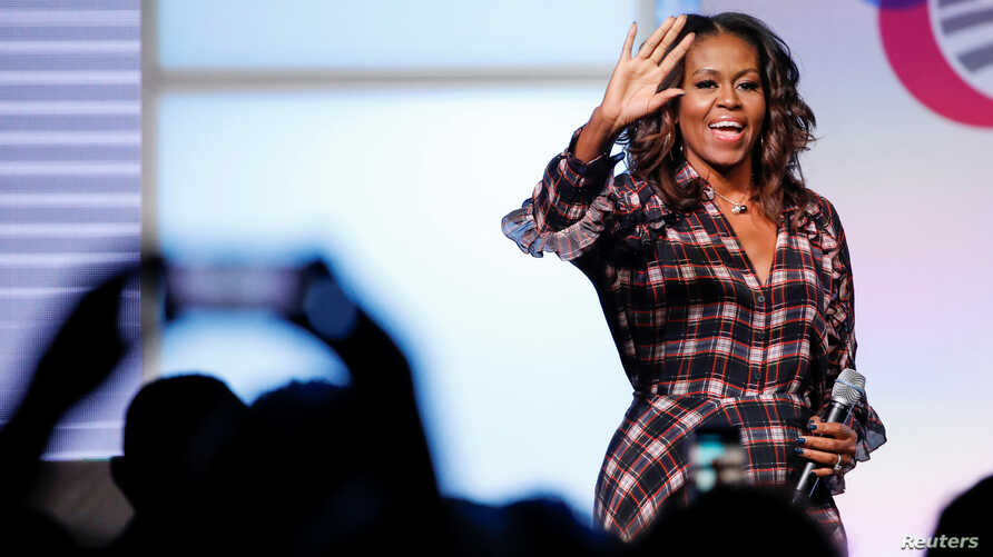 Former first lady Michelle Obama arrives on stage before speaking during the second day of the first Obama Foundation Summit in Chicago, Nov. 1, 2017.