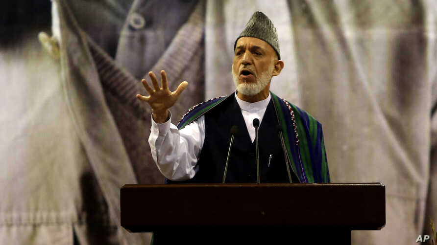 Afghan President Hamid Karzai, center, speaks during a ceremony honoring the late Commander Ahmad Shah Massoud, a beloved anti-Taliban fighter who was assassinated 13 years ago, in Kabul, Afghanistan, Sept. 9, 2014.