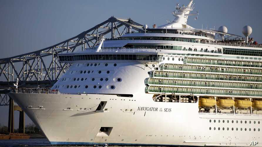 FILE - A Royal Caribbean cruise line pulls out of New Orleans on the Mississippi River, Feb. 2, 2013.