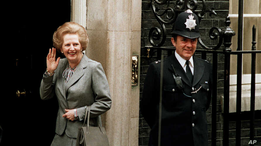 FILE - In this May 11, 1987 file photo, Britain's Prime Minister Margaret Thatcher waves to members of the media on returning to No. 10 Downing Street from Buckingham Palace after a visit with Queen Elizabeth II.