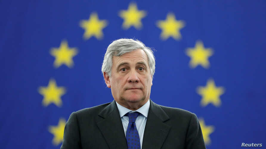 Newly elected European Parliament President Antonio Tajani stands on his desk after the announcement of the results of the election at the European Parliament in Strasbourg, France, Jan. 17, 2017.