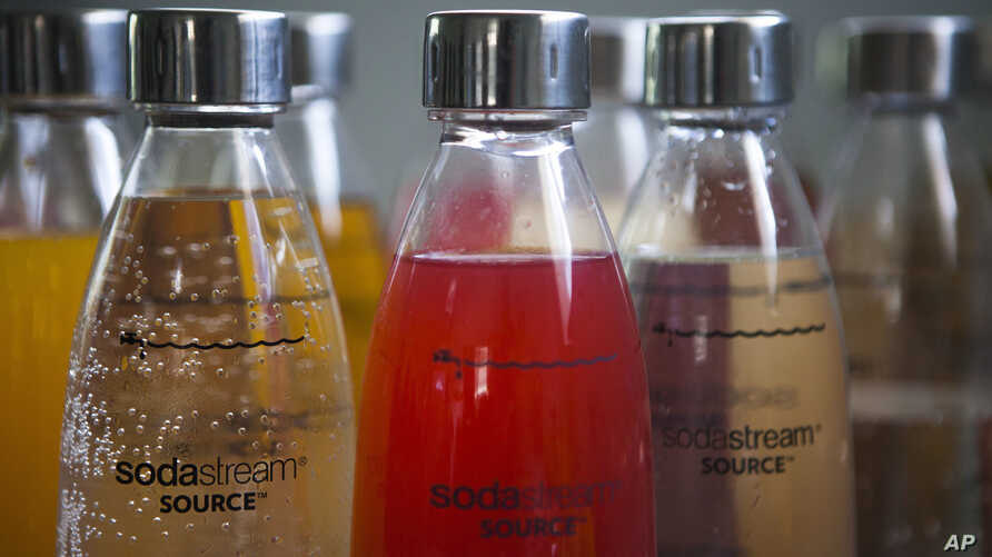 FILE - In this Sept. 2, 2015 file photo, SodaStream products are seen at the SodaStream factory near the Bedouin city of Rahat, Southern Israel. Beverage giant PepsiCo has bought SodaStream for $3.2 billion.