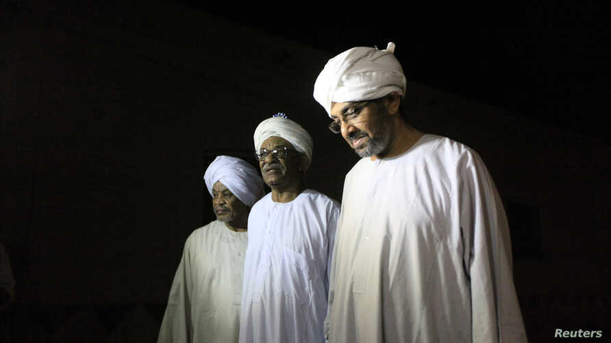 Political prisoners walk out after their release from Kober Prison in Khartoum, April 2, 2013.
