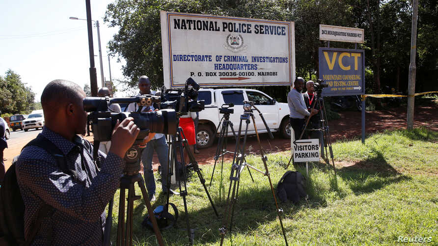 Journalists wait outside the Director of Criminal Investigation headquarters, following the arrest of several officials over corruption in Nairobi, Kenya May 28, 2018.