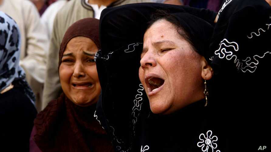 Egyptian women weep after a judge sentenced to death more than 680 alleged supporters of the country's ousted president over acts of violence and the murder of a policeman in the latest mass trial in the southern city of Minya, Egypt,  April 28, 2014