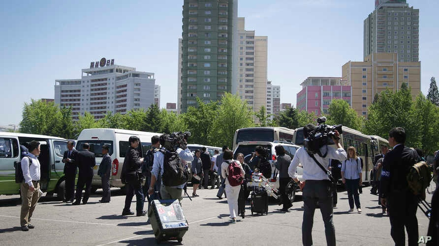 Foreign journalists leave a venue after being told that coverage plans had changed until further notice in Pyongyang, North Korea, May 8, 2016.