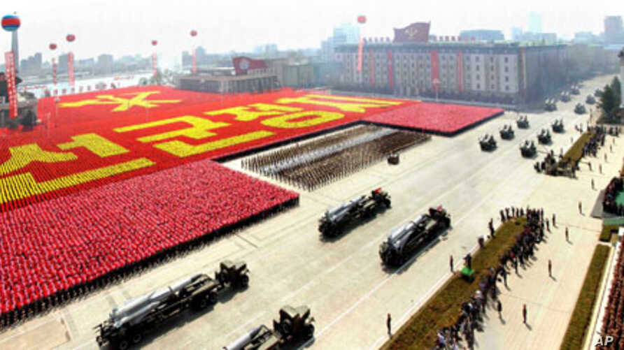 Rockets are carried by military vehicles during a military parade to celebrate the centenary of the birth of North Korea's founder Kim Il-sung in Pyongyang on April 15, 2012, in this picture released by the North's KCNA news agency on April 16, 2012.