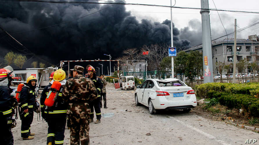 Firefighters and Chinese paramilitary police officers search an explosion site in Yancheng in China's eastern Jiangsu province, March 21, 2019. A huge explosion rocked a chemical plant in eastern China on March 21, killing or injuring dozens as it kn