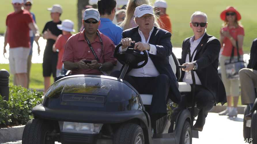FILE - Donald Trump drives himself around a golf course in Doral, Florida, March 6, 2016. Even thought the White House released no detailed accounting of much of President Trump's schedule over the weekend, according to a source, he played 18 holes S