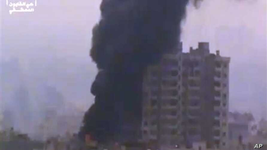 Ugarit News image of smoke and fire billowing from an explosion in Damascus, Syria, Feb. 6, 2013