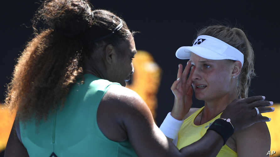 United States' Serena Williams consoles Ukraine's Dayana Yastremska after winning their third round match at the Australian Open tennis championships in Melbourne, Australia, Saturday, Jan. 19, 2019.