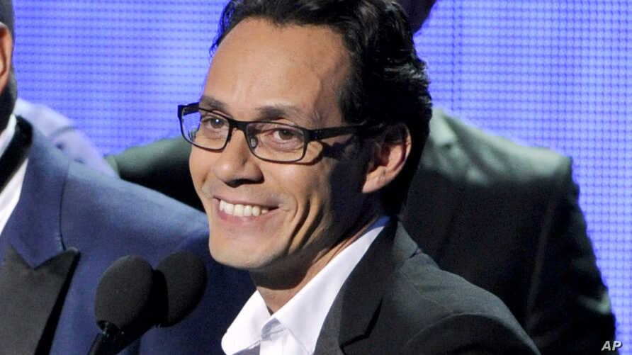 FILE - Marc Anthony, winner of the award for best salsa album, speak on stage at the 15th annual Latin Grammy Awards at the MGM Grand Garden Arena in Las Vegas, Nov. 20, 2014.