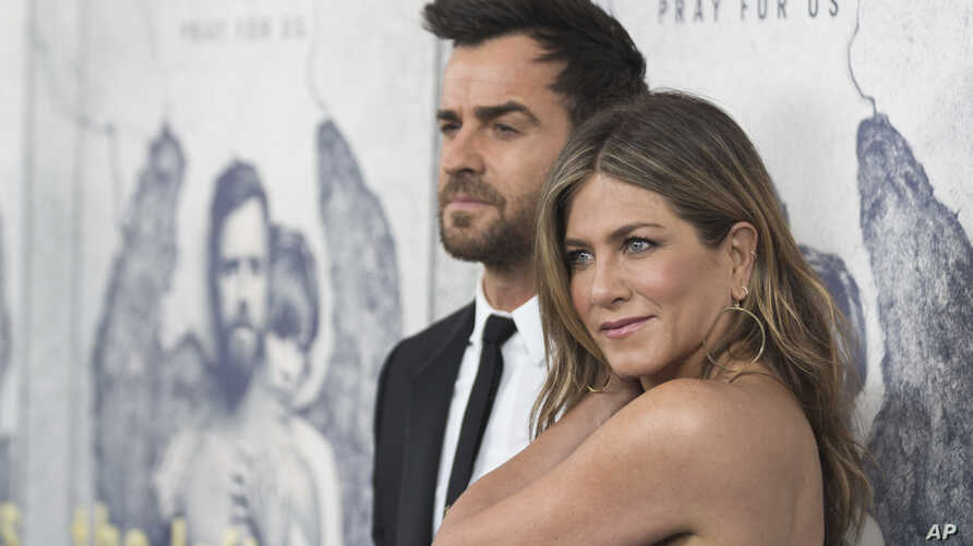 "FILE - Jennifer Aniston, right, and Justin Theroux arrive at the LA Premiere of ""The Leftovers"" Season Three at Avalon Hollywood in Los Angeles, April 4, 2017."