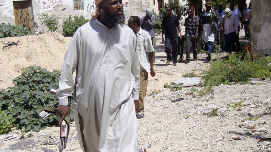 Former Al-Shabab senior official Muktar Robow is show near Mogadishu, June 29, 2010.