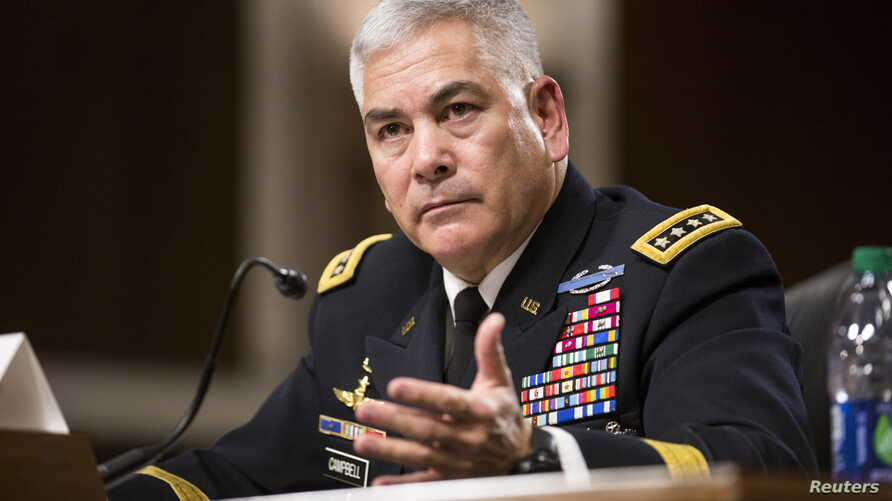 "U.S. Army General John Campbell, commander of the Resolute Support Mission and United States Force - Afghanistan, testifies before a Senate Armed Services Committee hearing on ""The Situation in Afghanistan"" on Capitol Hill in Washington, Oct. 6, 2015..."