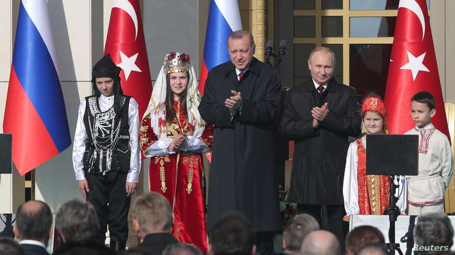 Turkish President Tayyip Erdogan and his Russian counterpart Vladimir Putin attend groundbreaking ceremony of the Akkuyu Nuclear Power Plant through videolink, at the Presidential Palace in Ankara, Turkey April 3, 2018.