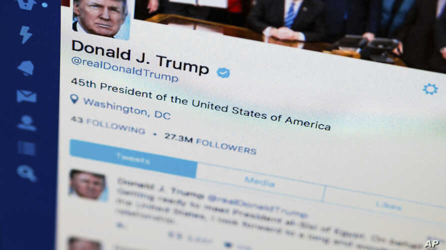 FILE - President Donald Trump's tweeter feed is photographed on a computer screen in Washington.
