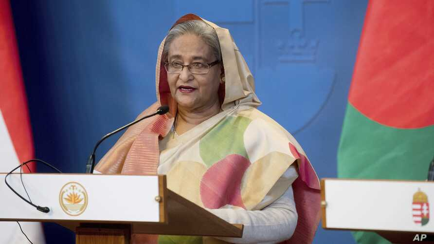 FILE - Bangladeshi Prime Minister Sheikh Hasina speaks at a news conference in Budapest, Hungary, Nov. 29, 2016. Leaders of the opposition Bangladesh Nationalist Party have accused the Hasina-led government of not making public details of an agreemen...