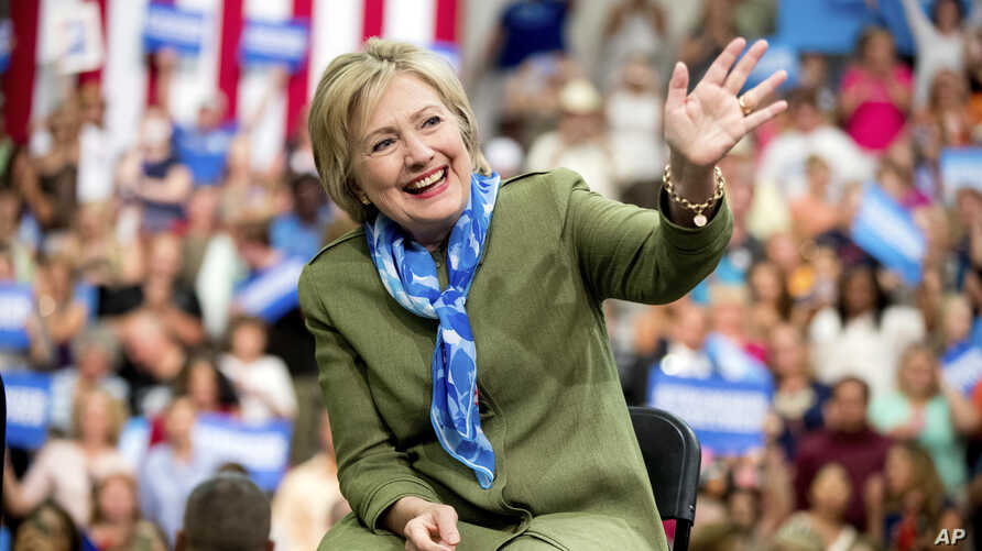 Democratic presidential candidate Hillary Clinton waves to members of the audience as she arrives at a rally at Adams City High School in Commerce City, Colorado, Aug. 3, 2016.