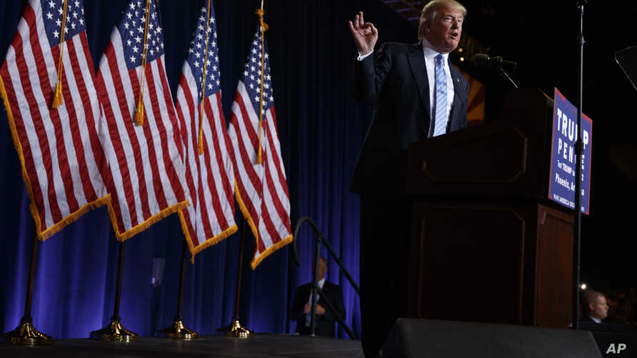 Republican presidential candidate Donald Trump delivers an immigration policy speech during a campaign rally at the Phoenix Convention Center, Wednesday, Aug. 31, 2016.