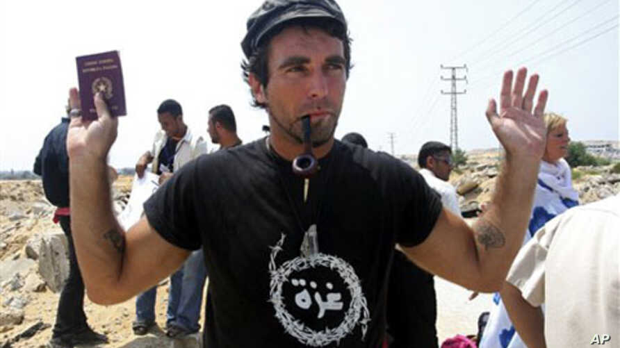 International activist Vittorio Arrigoni, from Italy, holds his passport during a protest against the Israeli siege on Gaza, in Gaza City (File 2008)