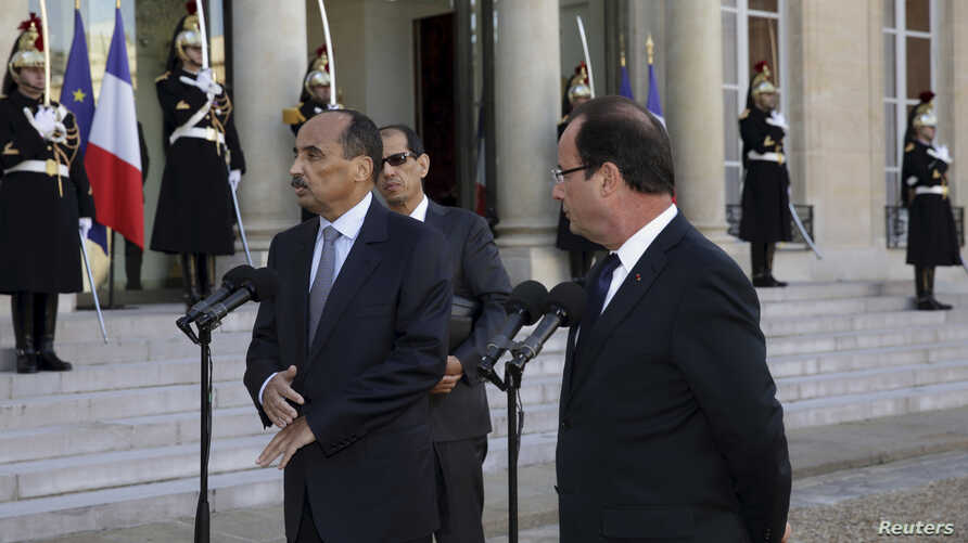 French President Francois Hollande, right, and Mauritania's President Mohamed Ould Abdel Aziz, Elysee Palace, Paris, Nov. 20, 2012.