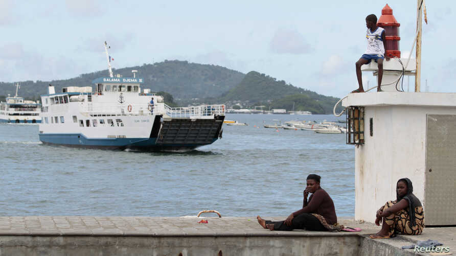 A boat arrives at Dzaoudzi on the Indian Ocean island of Mayotte, March 31, 2012.