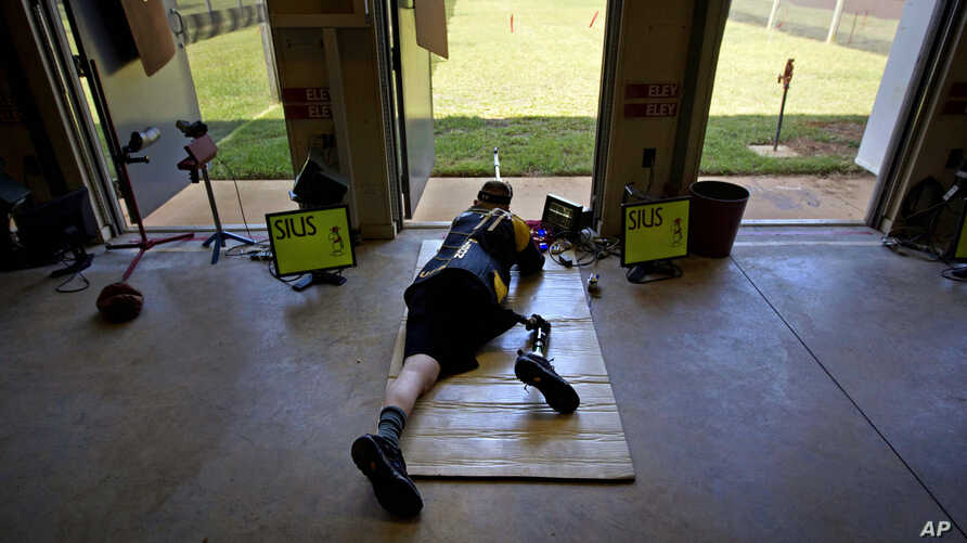 U.S. Army Sergeant Josh Olson takes practice on the shooting range at Fort Benning, Georgia and he trains for the upcoming Paralympic Games, May 30, 2012.