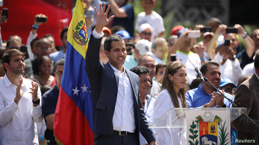 Venezuelan opposition leader and self-proclaimed interim president Juan Guaido waves to supporters during a rally against Venezuelan President Nicolas Maduro's government in Caracas, Venezuela, Feb. 2, 2019.