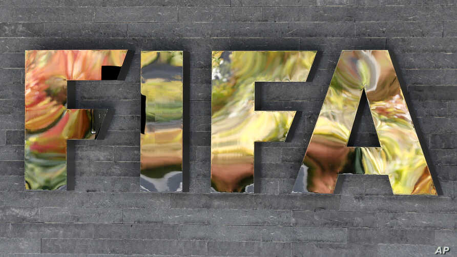 The FIFA logo is fixed on a wall of the FIFA headquarters during a meeting of the FIFA Executive Committee in Zurich, Switzerland, Sept. 25, 2015.