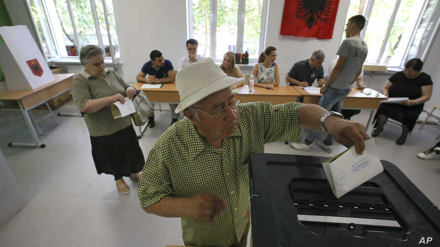 An Albanian man casts his ballot at a polling station in Tirana, June 25, 2017.