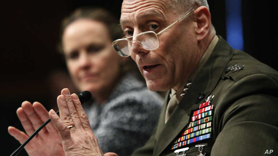 "FILE - Marines Lt. Gen. John Paxton testifies before a Senate committee on Capitol Hill, Feb. 22, 2010. Now a general and the Marines' assistant commandant, Paxton told senators on March 15, 2016, that the Marine Corps ""is no longer in a healthy posi"