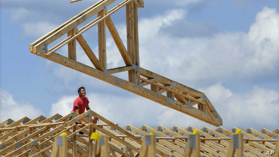 FILE - A construction worker builds a commercial complex in Springfield, Illinois.