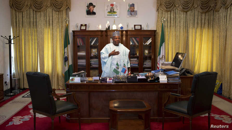 Governor of Borno state Kashim Shettima stands by his desk in the state house in Maiduguri May 22, 2014.