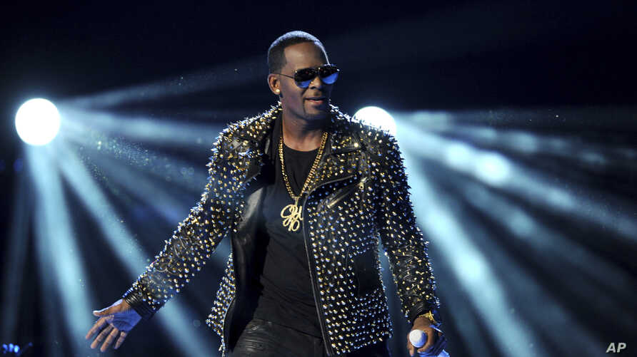 FILE - In this June 30, 2013 file photo, R. Kelly performs at the BET Awards at the Nokia Theatre in Los Angeles. R. Kelly is announcing a new tour, but it won't be in the United States.