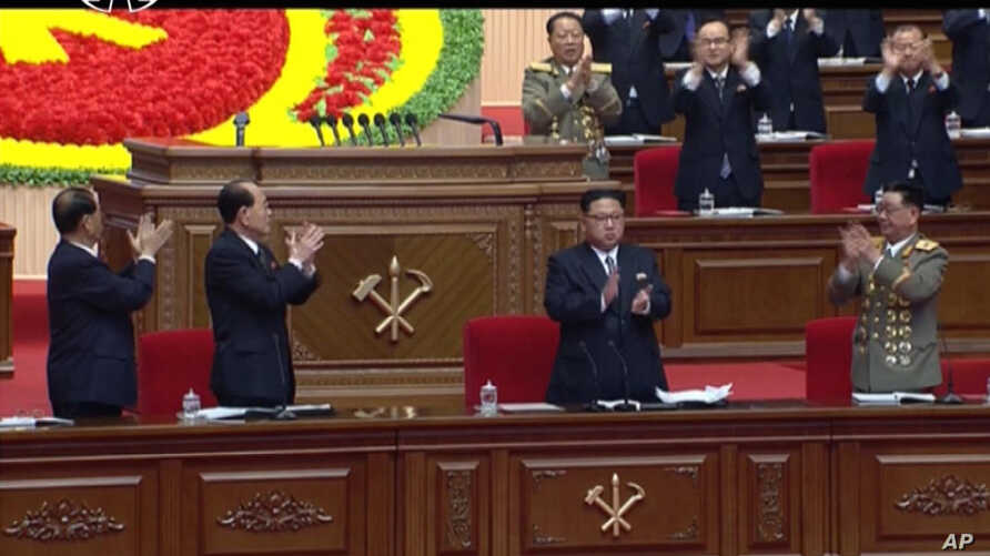 In this frame taken from TV, North Korean leader Kim Jong Un, center, applauds during the ruling party congress in Pyongyang, North Korea, May 7, 2016.