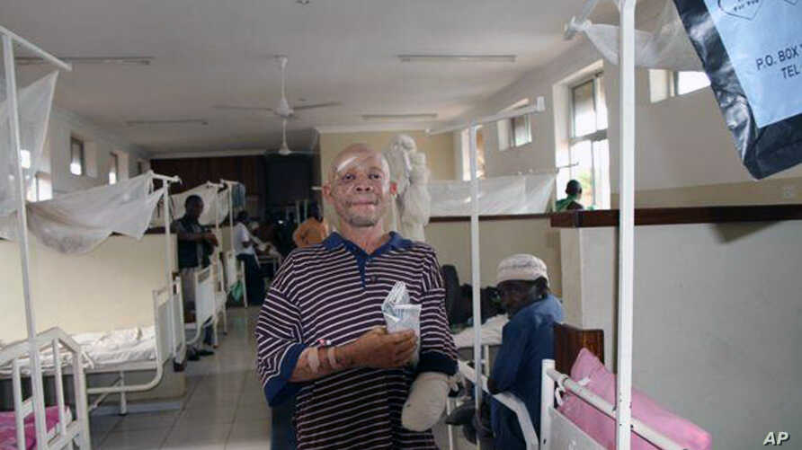 FILE - Albino Said Abdallah, who lost his left hand in an attack, is seen recovering at Morogoro hospital, Tanzania, May 7, 2010.