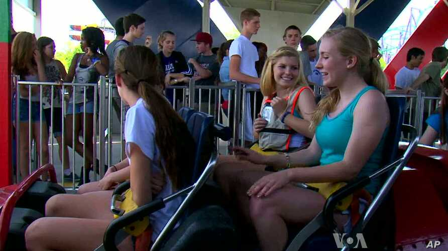 Students prepare to ride the roller coaster during Physics Day at Six Flags America amusement park in Maryland.